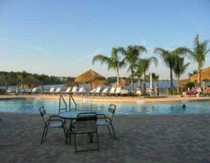 Swimming pool and sandy beach by restaurant at Bahama Bay Resort & Spa Orlando Florida